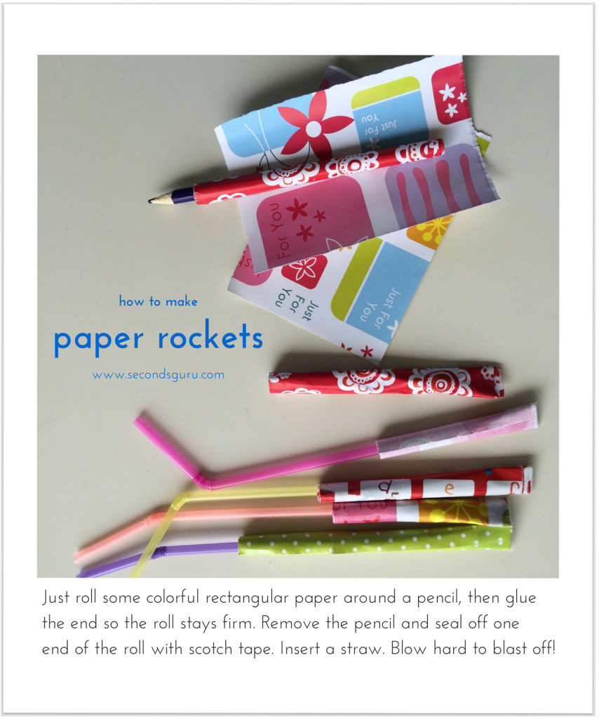 A great way to recycle old/leftover wrapping! Just roll some colorful rectangular paper around a pencil, then glue the end so the roll stays firm. Remove the pencil and seal off one end of the roll with sellotape. Insert a straw. Blow hard to blast off!