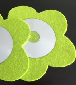 DIY | Combine old CDs with felt shapes to create coasters in a jiffy. Quick and easy crafts for kids!