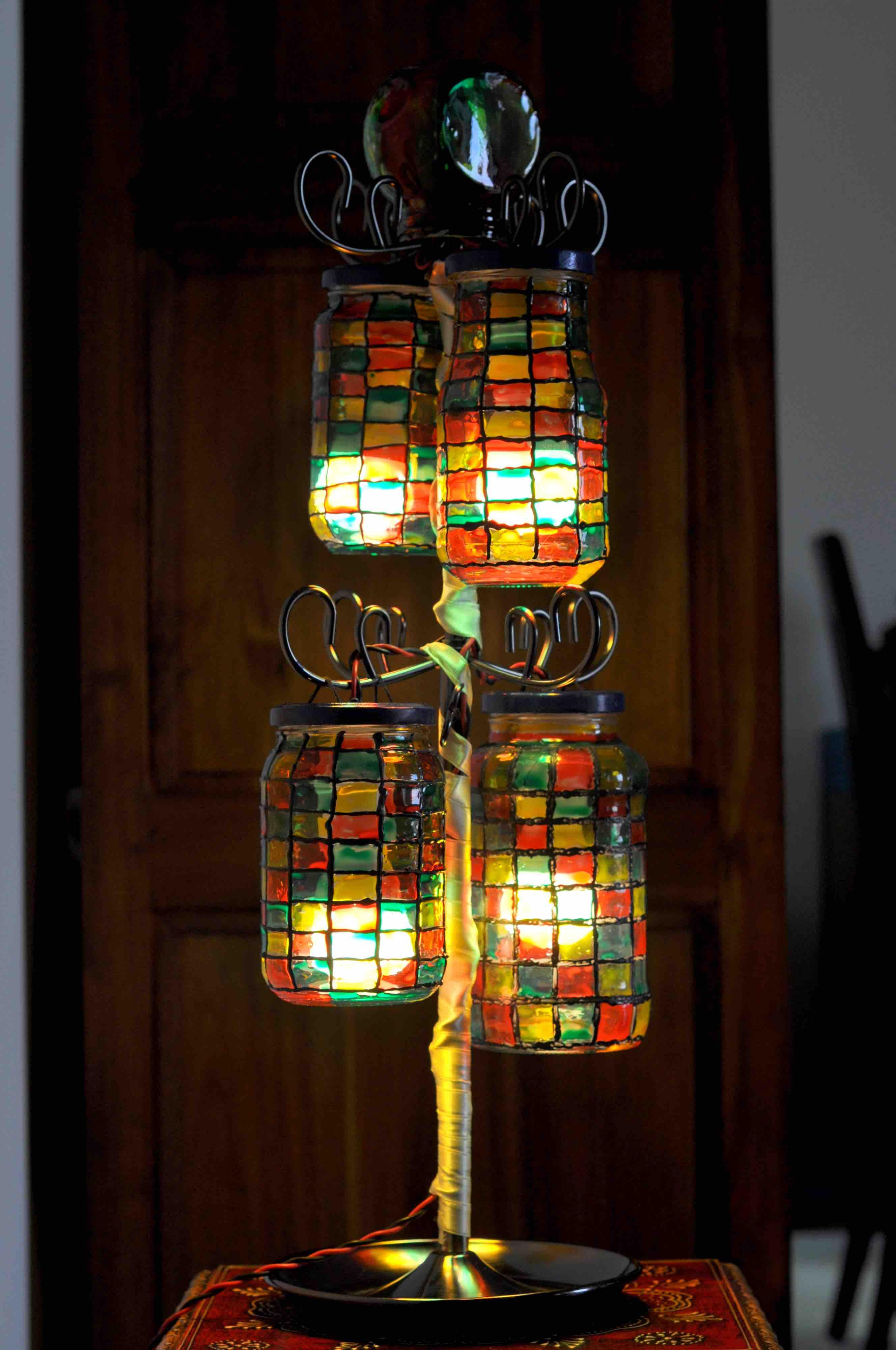 Upcycle old glass jars into a lamp! Once you are done with the pastas / pickles / etc, upcycle the container into a beautiful decor centerpiece with this DIY