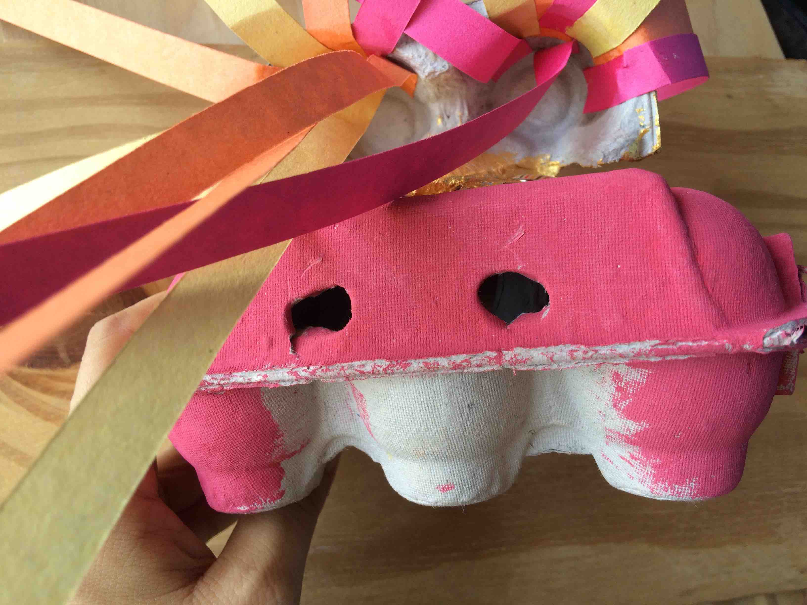 Make a dragon out of old eggboxes - and punch two holes at the back to turn it into a hand puppet