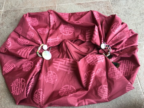 Upcycle umbrella to tote bag! Step 3: Shape the bag and secure the loops with accessories