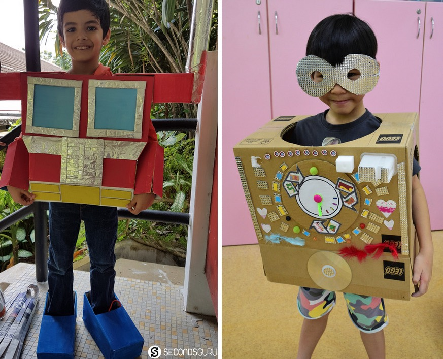 KIndergarten kids rocking costumes made out of recycled materials. How cool are these robot costumes built with Lego boxes!