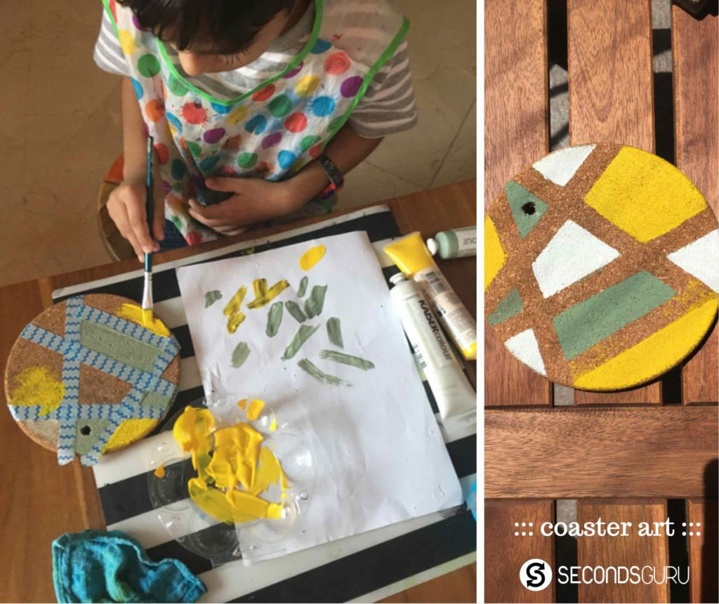 Using paints to upcycle coasters and renew old cork base in kids crafts
