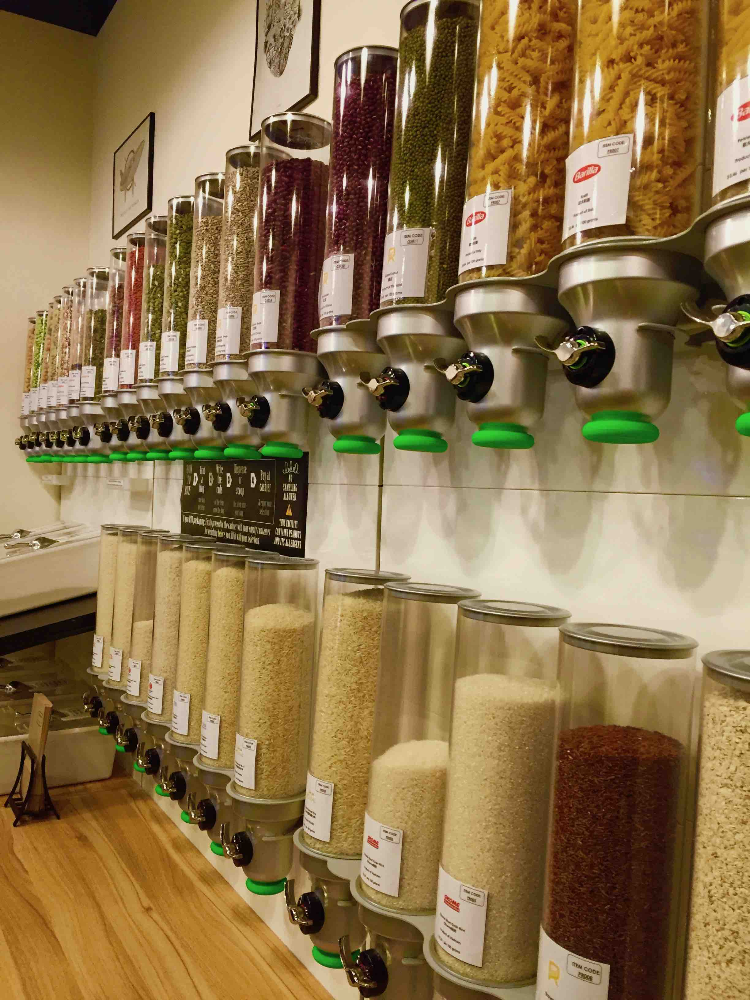 Packaging free dry goods at Reprovisions, a zero waste store in Singapore