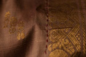 Spot of colour on a patchworked Kanchipuram silk sari