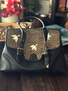 Old luxury leather bag upcycled into new one of a kind piece